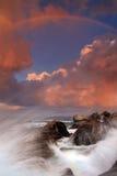 Rainbow over stormy sea Stock Photo