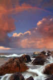 Rainbow over stormy sea. At summer Stock Photo
