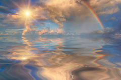 Rainbow over stormy sea. In the early morning Royalty Free Stock Photography