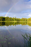 Rainbow over Swedish lake Royalty Free Stock Photography