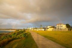 Rainbow over Sydney city Stock Photos