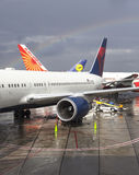 Rainbow over three airplanes. Royalty Free Stock Images