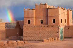 Rainbow over a traditional house in Morocco Stock Images