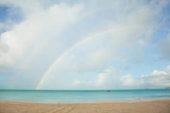 Rainbow over tropical beach Stock Photo