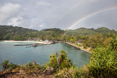 Rainbow Over Tropical Island Stock Image