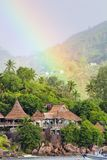 Rainbow over tropical island and luxurious hotel Royalty Free Stock Photo