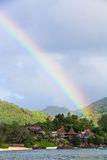 Rainbow over tropical island and luxurious hotel Royalty Free Stock Photos