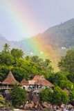 Rainbow over tropical island and luxurious hotel Royalty Free Stock Image