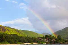 Rainbow over tropical island and luxurious hotel Stock Images