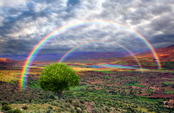 Rainbow over the valley Stock Photos