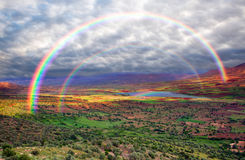 Rainbow over the valley Royalty Free Stock Photos