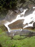 Rainbow over Vernal Falls in Yosemite. Walking up the mist trail of Vernal Falls in Yosemite, CA Royalty Free Stock Images