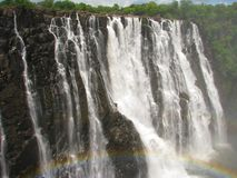 Rainbow over Victoria Falls on Zambezi River Stock Photos
