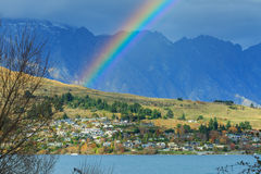Rainbow over the village Stock Images