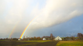 Rainbow over the village Royalty Free Stock Photography