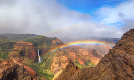 Rainbow over Waimea Canyon Stock Image