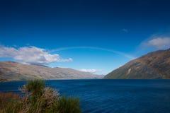 Rainbow over Wakatipu Lake in Queenstown, New Zealand. Rainbow over Wakatipu Lake after the rain. Queenstown, New Zealand Stock Photos