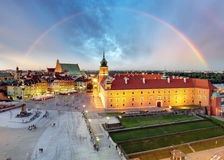 Rainbow over Warsaw Old Town square, Poland Stock Photos