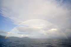 Rainbow over water Stock Photo