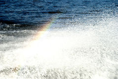 Rainbow over water splashes. Beautiful rainbow against a splash of water royalty free stock images