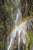 Rainbow over the waterfall Stock Photography