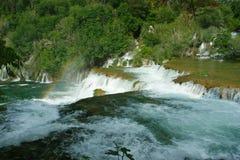 Rainbow over waterfalls. Krka waterfalls and rainbow over stock images
