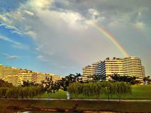 Rainbow over waterfront housing Royalty Free Stock Image