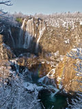 Rainbow over winter waterfall Stock Images