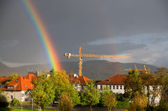 Rainbow over yellow construction crane Royalty Free Stock Images