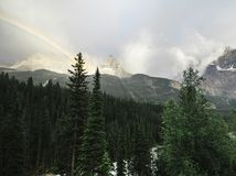 A rainbow over the Yoho Valley in BC. After a brief summer storm Royalty Free Stock Images