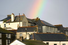 Rainbow overhead. Rainbow appearing over the top of seaside cottages Royalty Free Stock Photo