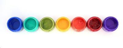 Rainbow paint pots Royalty Free Stock Photos