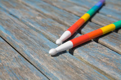 Rainbow-painted drumsticks Royalty Free Stock Photography