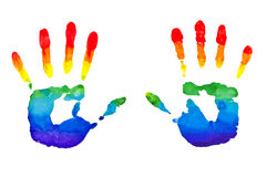 Rainbow painted hands. Rainbow painted hand shape isolated on white stock photos