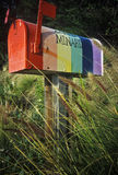 Rainbow painted mailbox Stock Photo