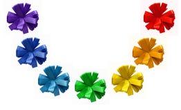 Rainbow painted ribbon cornflower bows. Isolated on white background Stock Images