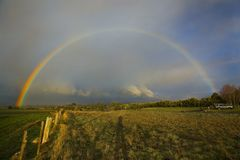 Rainbow Pair. Rainbow with secondary rainbow clearly visible as the sun begins to set Royalty Free Stock Photography