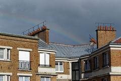 Rainbow on paris roofs Royalty Free Stock Photos