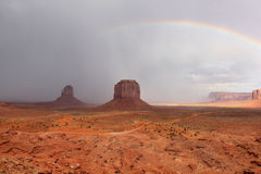 Rainbow and Passing Storm - Monument Valley, AZ Stock Photos