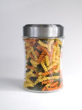 Rainbow Pasta. Rainbow Rotini Pasta in Glass Jar on White Stock Images