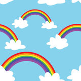 Rainbow Pattern. A seamless pattern of rainbows and clouds on a blue background Vector Illustration