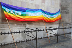 Rainbow peace flag during a demonstration of Italian pacifists b Stock Photos