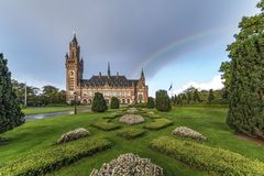 Rainbow on the Peace Palace, Vredespaleis in Dutch. End of the summer falls on the Peace Palace hesitating between rain and sun. It is on of the most visited stock images