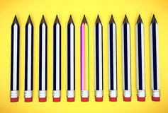 Rainbow pencil stands out from other pencils Stock Photo