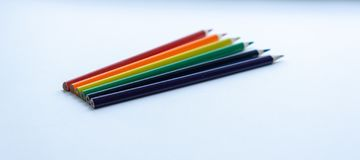 Set of six sharp rainbow-colored pencils except blue on a white background. Selective focus. royalty free stock photos