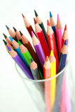 Rainbow Pencils. A glass containing brightly coloured pencils stock photo