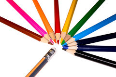 Rainbow pencils and eraser isolated. A picture of rainbow pencils and eraser on white background Stock Photos
