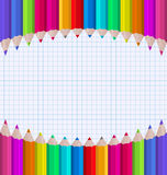 Rainbow of pencils on paper sheet background Royalty Free Stock Photo