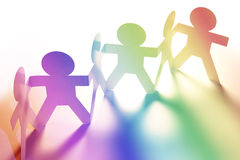 Rainbow people. Paper doll people holding hands Stock Photography