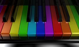 The rainbow piano. The black piano with keys of different colours of a rainbow Stock Images